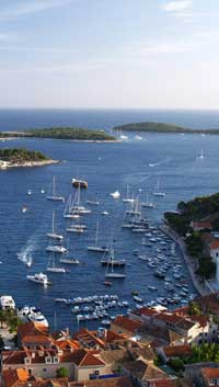 coast of Hvar with sailing yachts